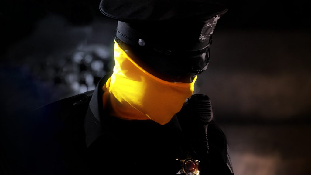 Policeman in a yellow mask - Watchmen HBO